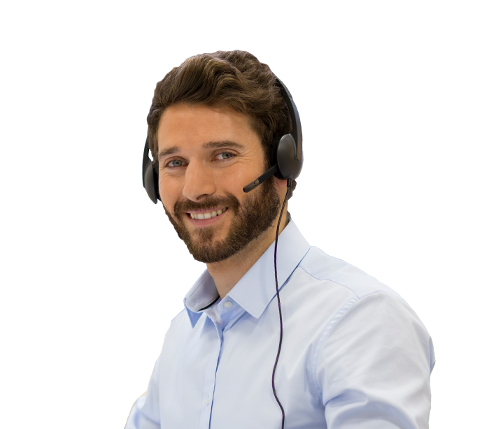 A young bearded man smiling in a light blue shirt wearing a head set from customer services